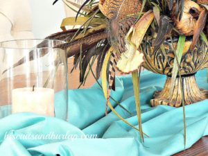 Centerpiece with Peacock feathers and satin