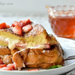 french toast on plate with syrup behind