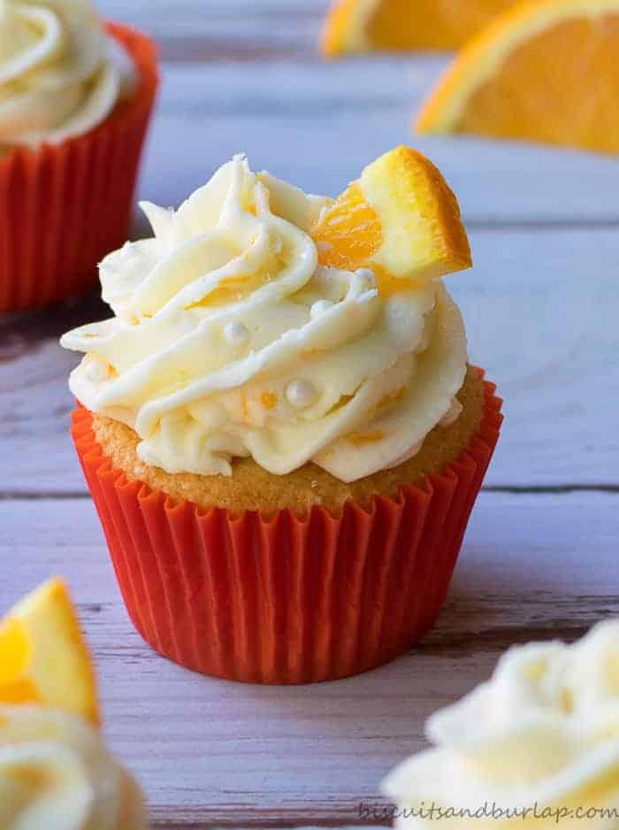 Orange cupcakes with cream cheese orange frosting from BiscuitsandBurlap.com
