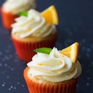 Orange cupcakes with cream cheese orange frosting from BiscuitsandBurlap.com