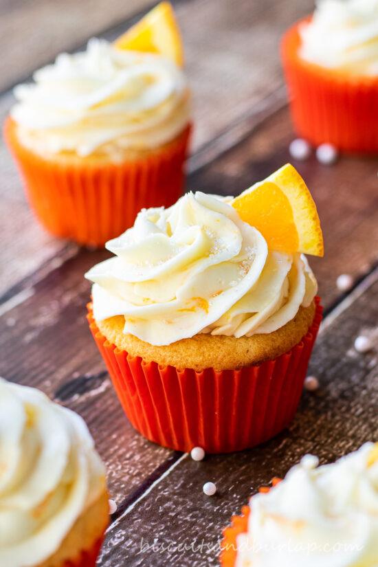orange cupcakes on board