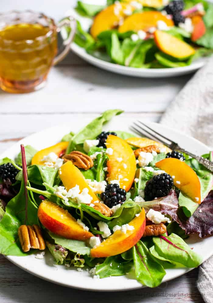 Salad with peaches, blackberries, pecans and basil vinaigrette