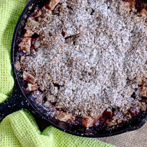 Apple Crisp with Cranberries is the perfect fall dessert baked in an iron skillet.