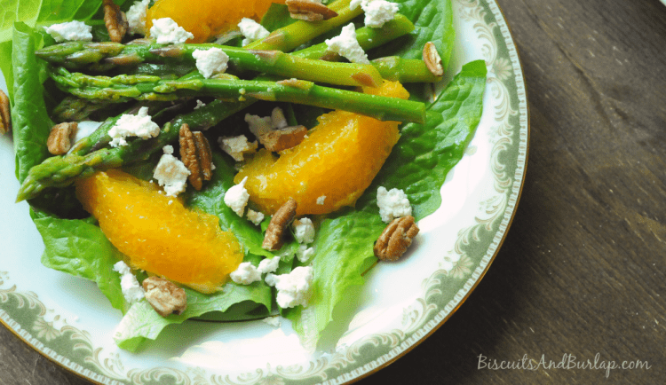 Salad on plate with oranges and goat cheese