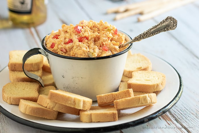 Homemade Pimento Cheese with a smoky twist and a spicy kick is perfect for snacks and sandwiches on its own. Use it in any recipe calling for Pimento Cheese as an ingredient to take your dish up a notch or two.