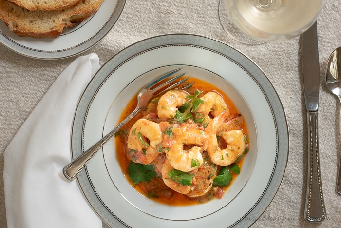 Shrimp in a buttery sofrito sauce is simple to make. Served over a thick slice of toasted sourdough bread you'll want extra bread to get every last drop of the mouthwatering sauce.