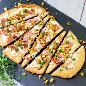 Flatbread appetizers with a unique blend of flavors from pistachios, burrato and proscuitto