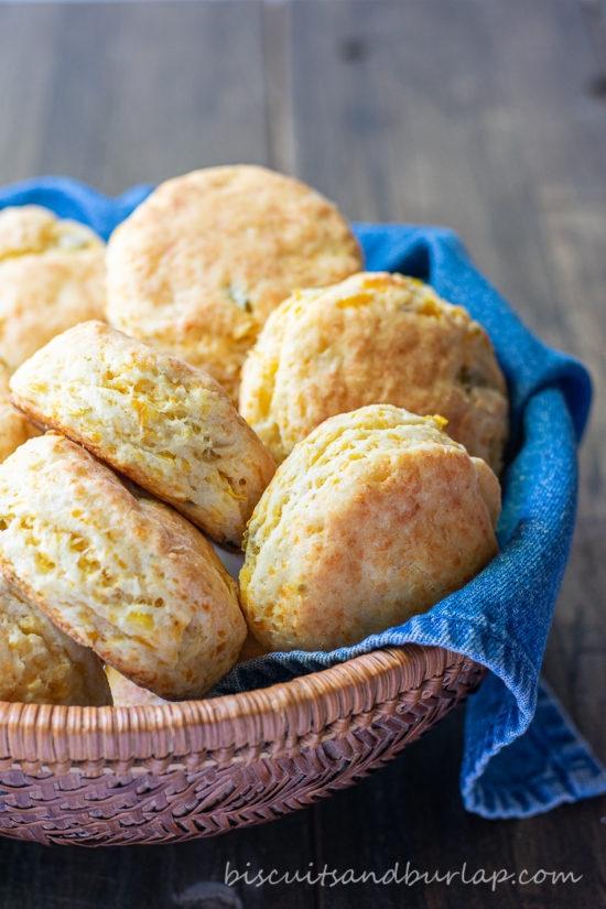 Biscuits similar to mexican cornbread in basket with denim napkin