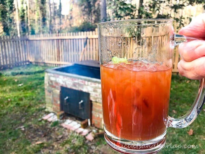 bloody mary with bbq pit in background
