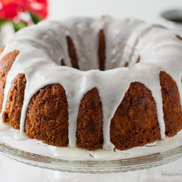 apple cider cake with flowers and coffee behind