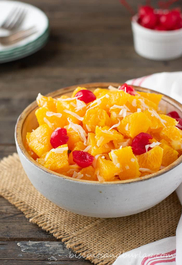 ambrosia in bowl with cherries behind