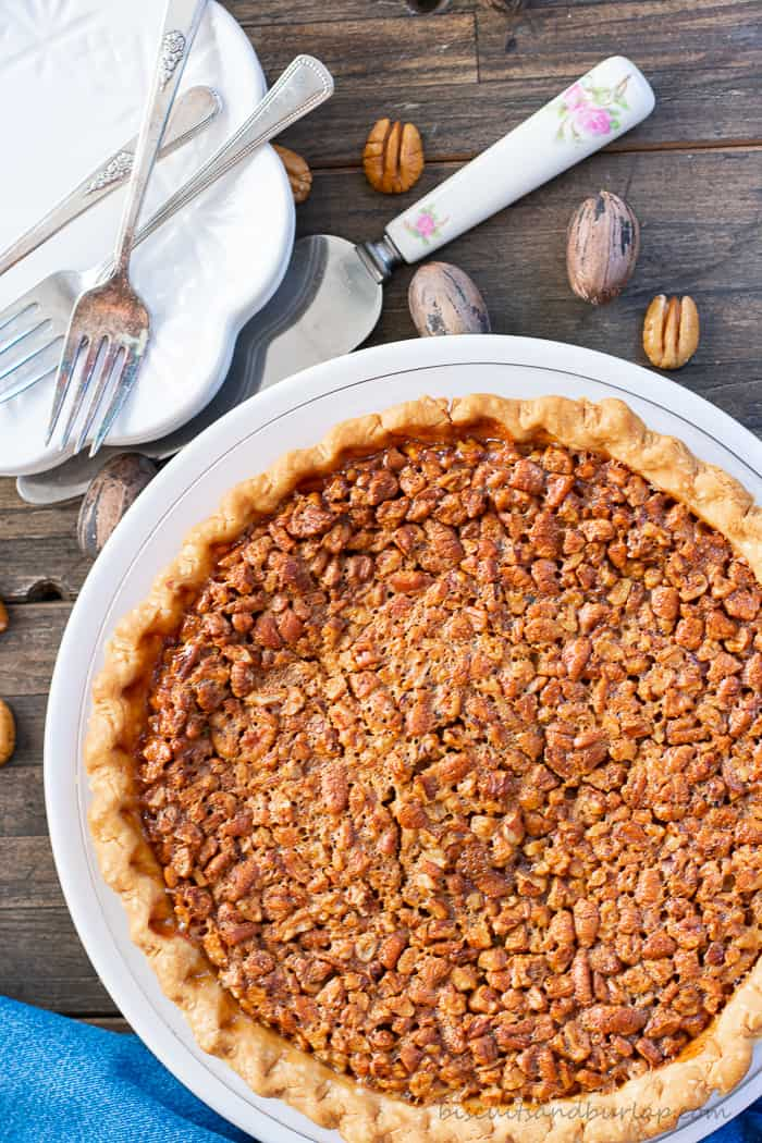 whole pecan pie with plates & forks