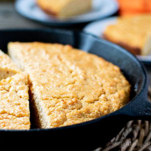 sweet potato cornbread in skillet with slices behind