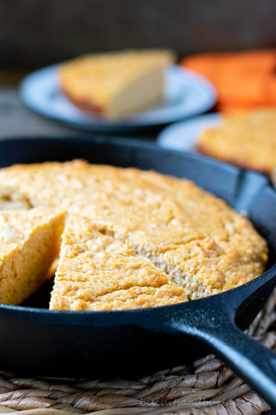 vertical shot of sweet potato cornbread in skillet