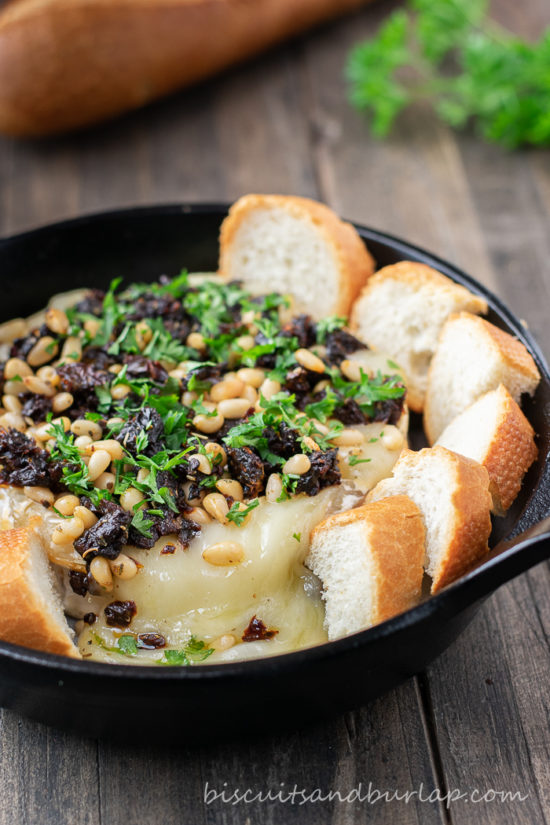 baked brie cheese in small iron skillet