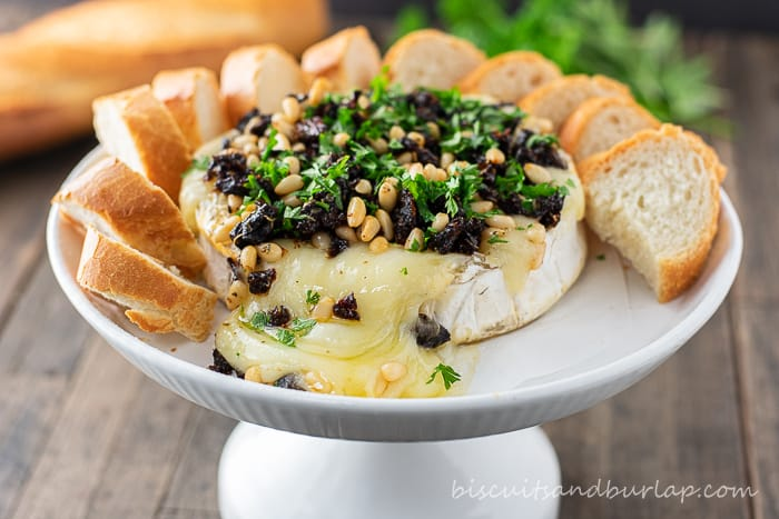 baked brie on stand with crostini