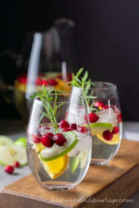 white sangria in glasses with cranberries