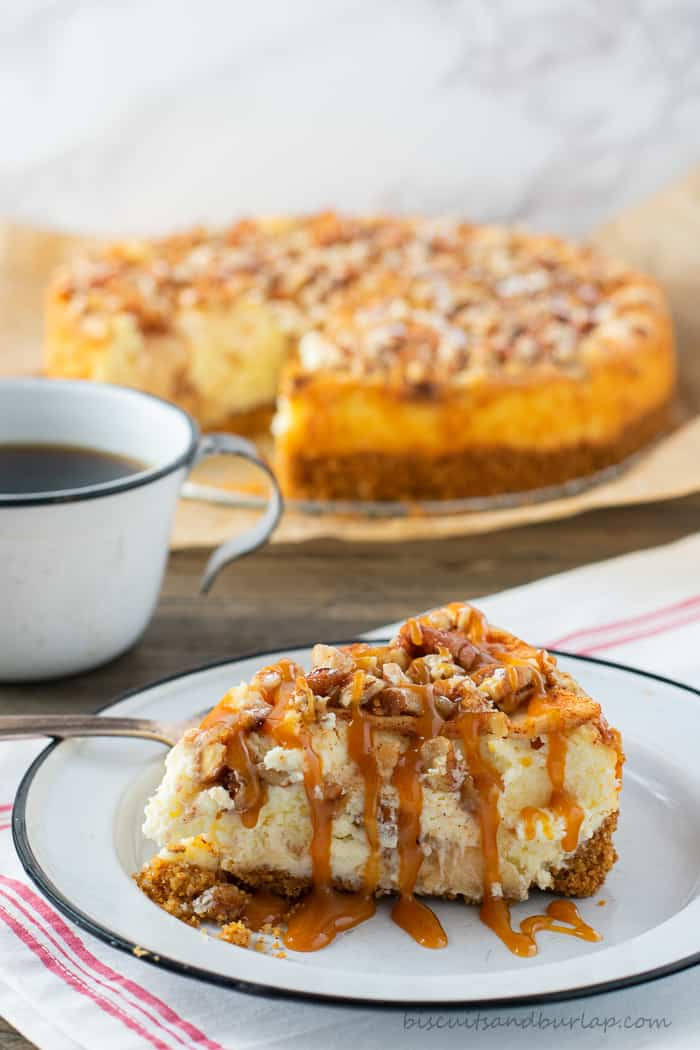 slice of apple cheesecake with caramel drizzed