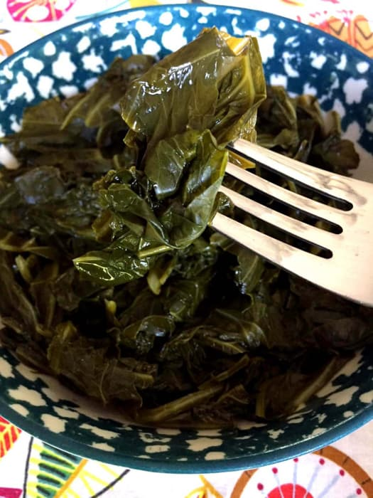 close up of collard greens with fork