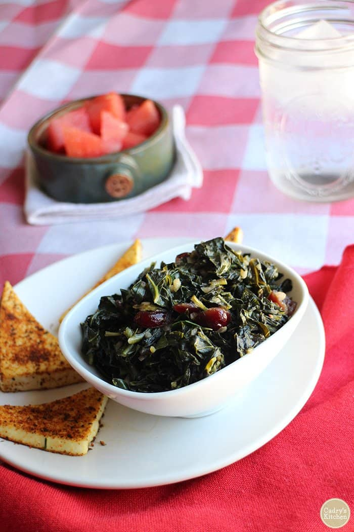 smoky sweet collard greens in white bowl