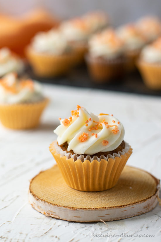 carrot cupcake on coaster with more in back