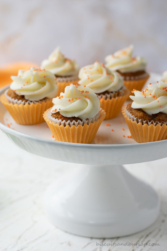 several carrot cake cupcakes on stand