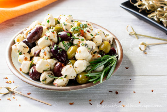 bowl of mozzarella pearls and olives