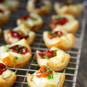 goat cheese appetizers in rows on rack