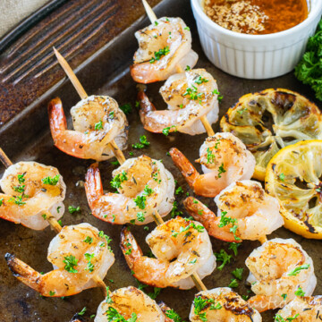 grilled shrimp skewers on pan