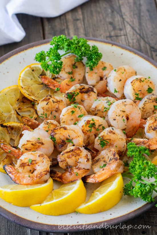 grilled shrimp on plate with lemons & parsley