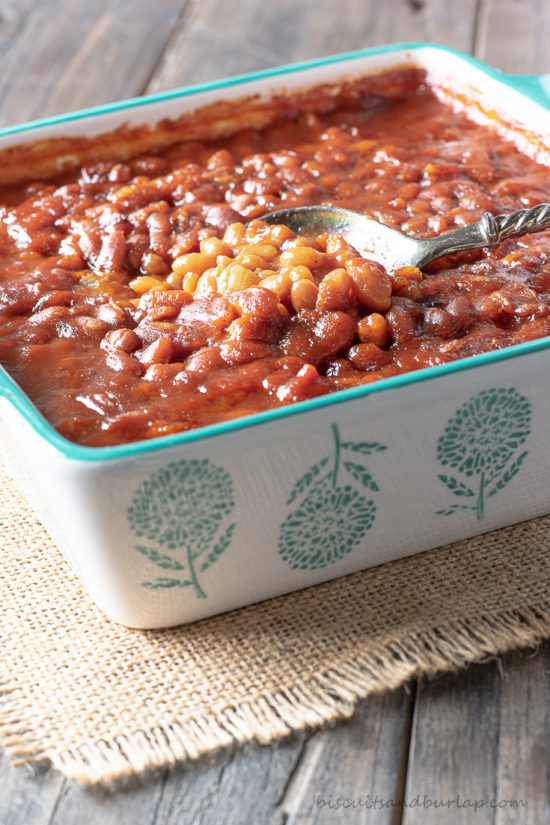 spoon in dish of beans
