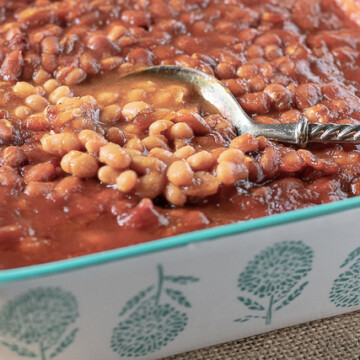 beans in dish with spoon
