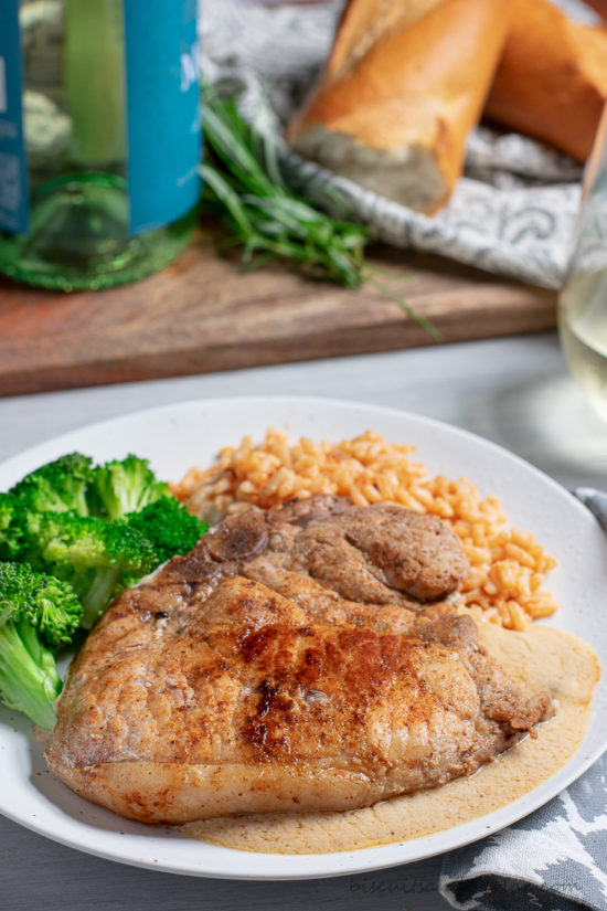 pork chop on plate with broccoli & rice