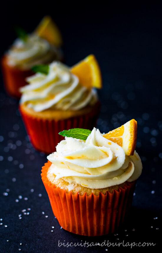 orange cupcake with 2 more behind