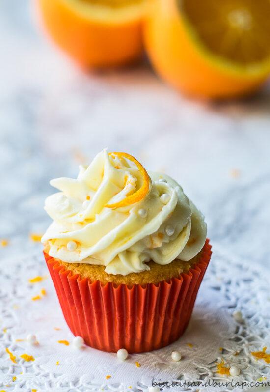 orange cupcake with oranges behind