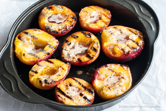 grilled peach halves on pan