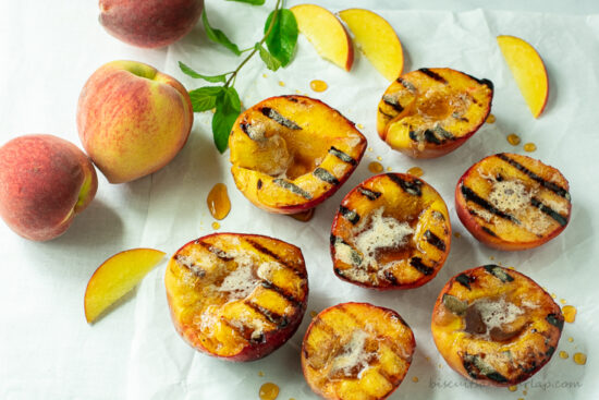 grilled peach halves with whole peaches