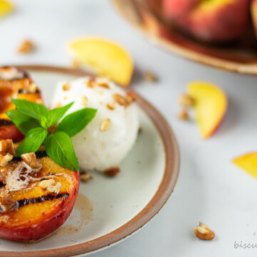 grilled peach haves on plate with ice cream