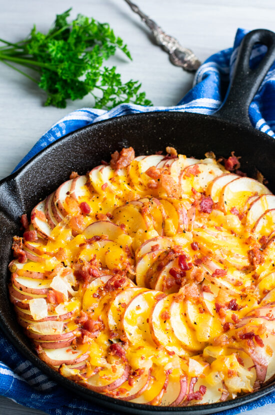 skillet potatoes with cheese on top