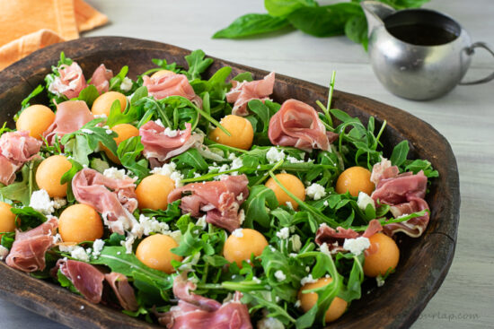 horizontal shot of melon and prosciutto salad