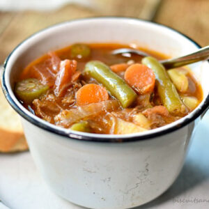 vegetable soup in white cup
