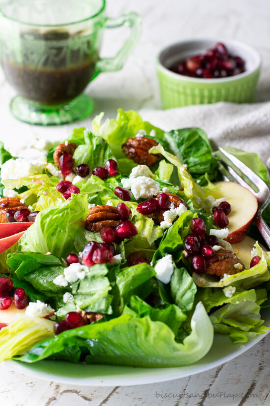 fall green salad with pomegranate seeds