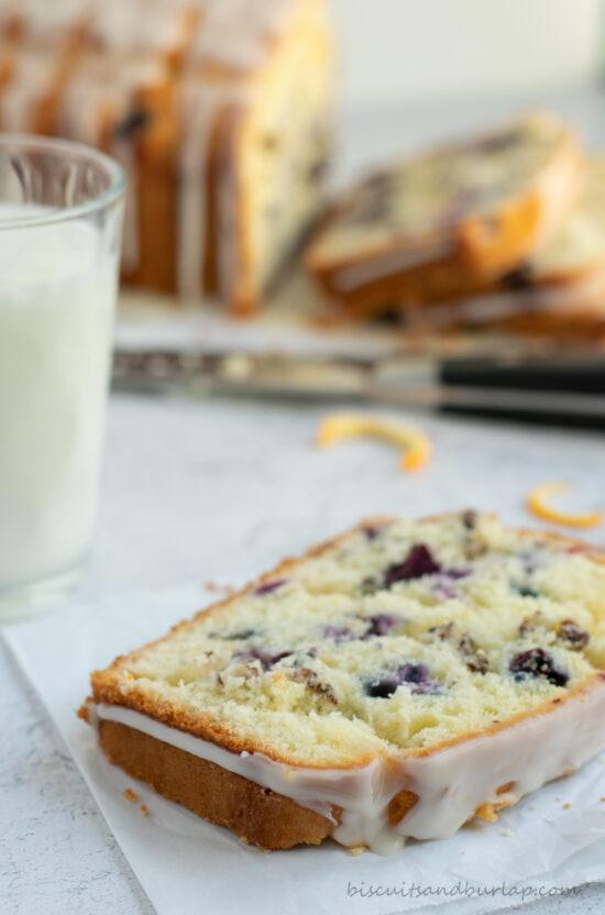 slice of blueberry orange bread with milk
