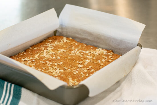 breakfast bars in pan with parchment