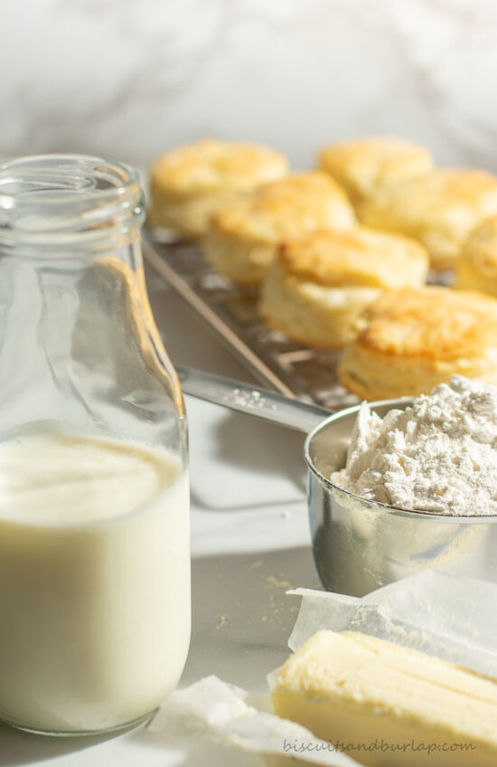 buttermilk biscuits in background with ingredients in front