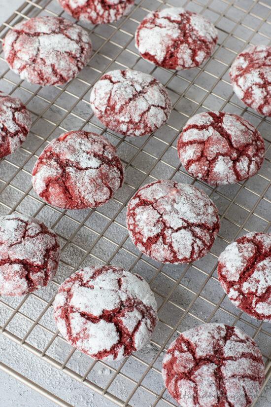 red velvet crinkle cookies on rack