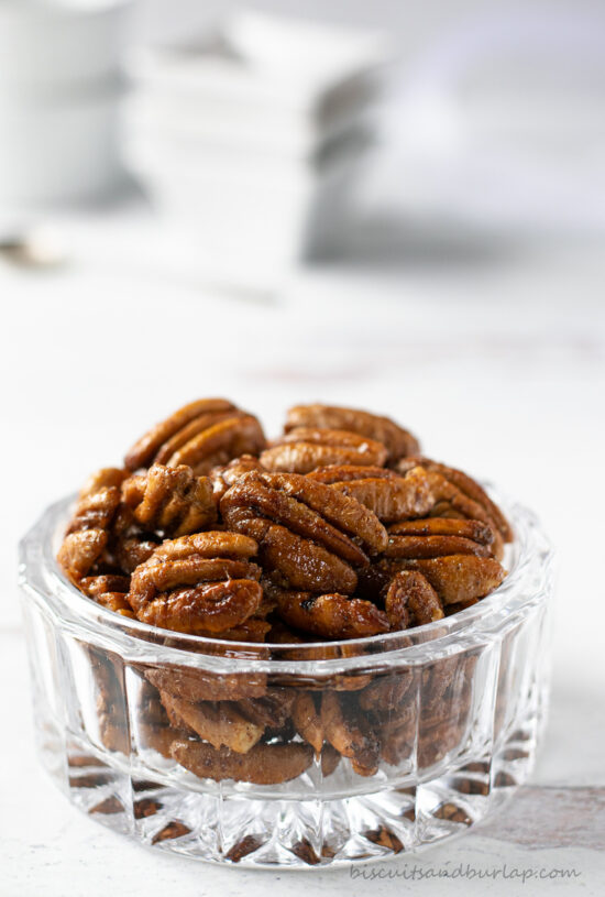 glass bowl with spiced pecans