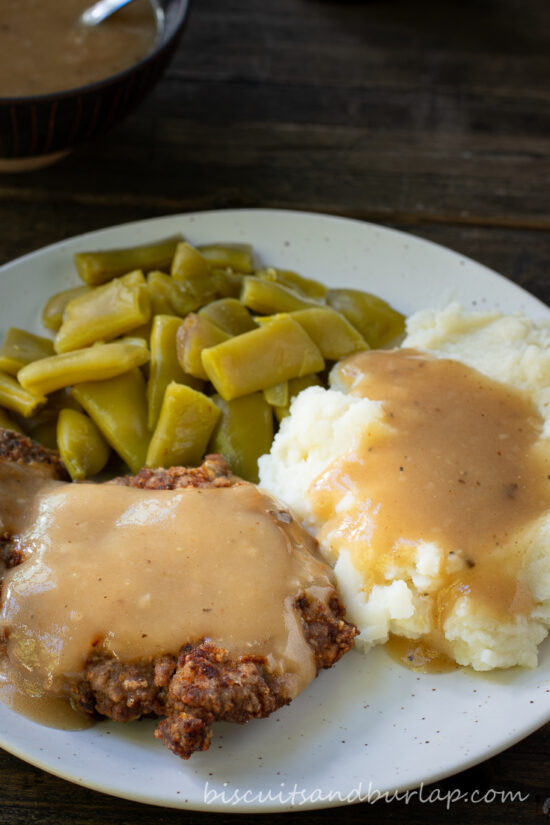 country fried steak, potatoes and beans