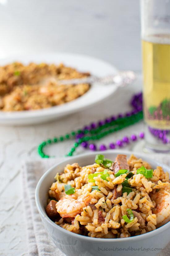 bowl of jambalaya with beer & beads