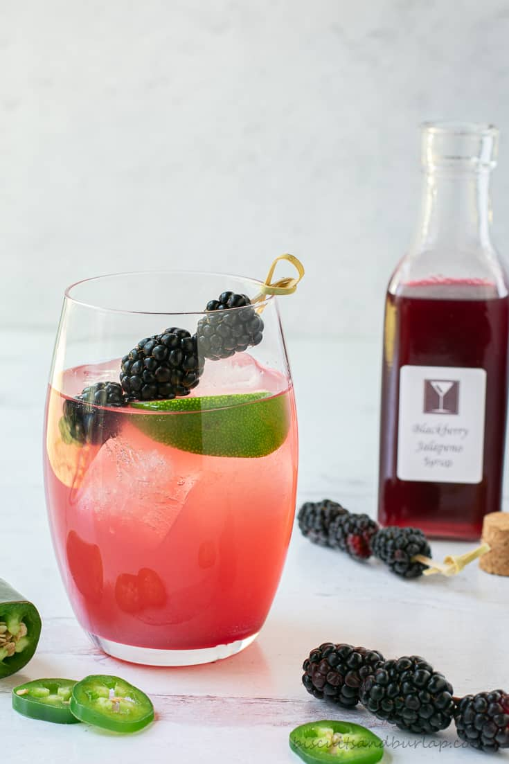 blackberry margarita with syrup bottle